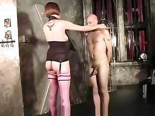 Domme Uses A Whoop On A Stud And Ties His Man Sausage Up